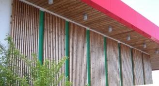 Wooden facade – shop SPAR Kočevje after three years of weathering exposure